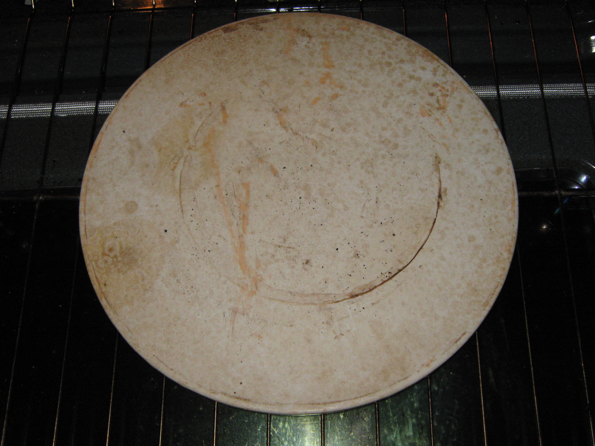 How To Clean A Burned Pizza Stone Ehow Uk